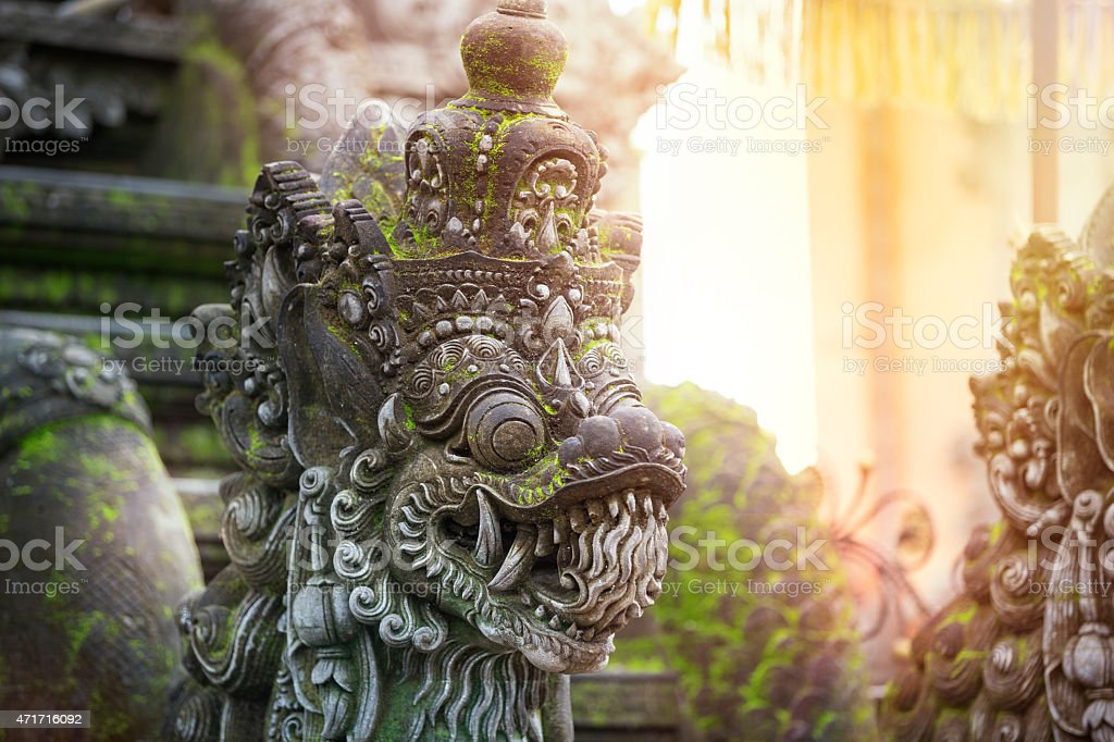 Balinese stone sculpture art and culture stock photo