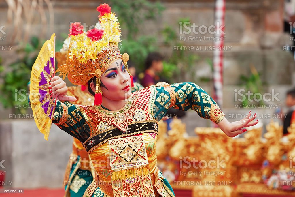 Balinese woman dancing traditional temple dance Legong stock photo