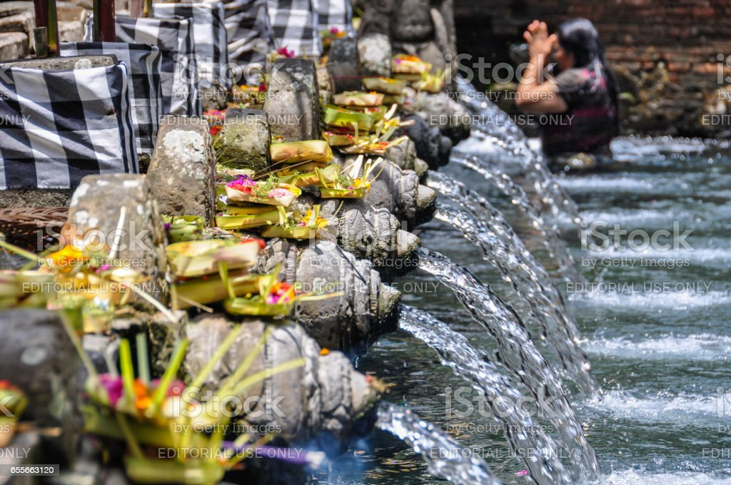 Balinese woman taking purifying bath in Tirta Empul in Bali, Indonesia stock photo