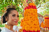 Balinese woman with religious offering