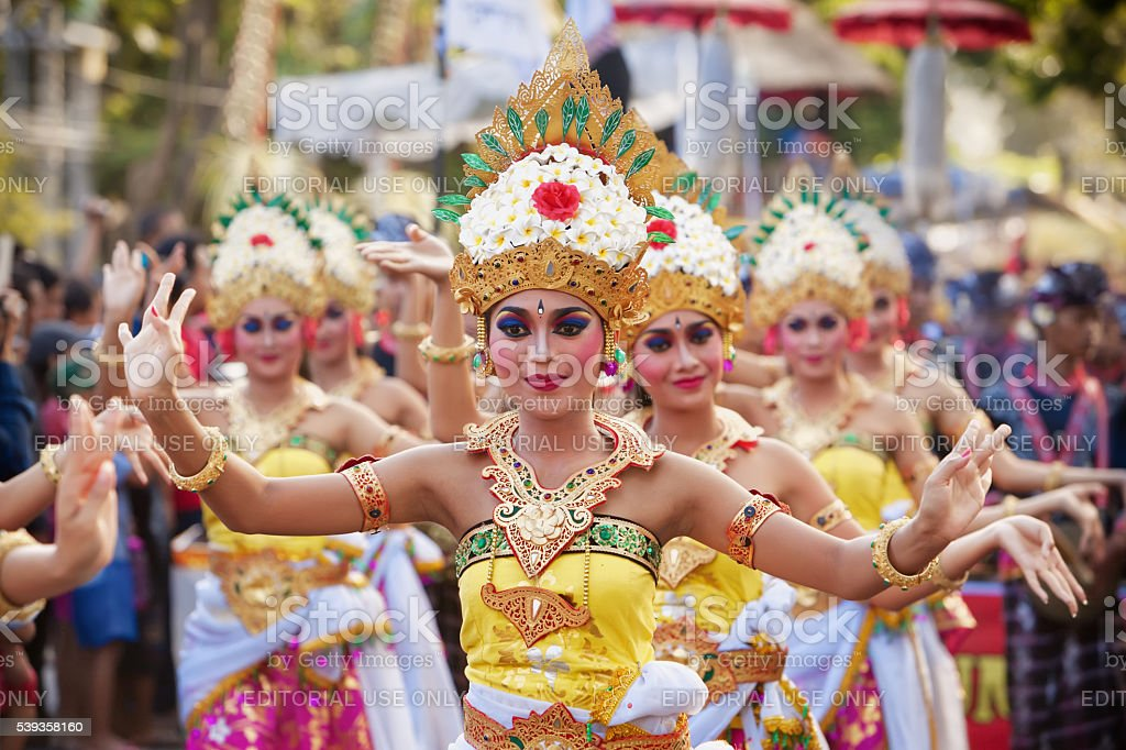 Balinese women dancing traditional temple dance stock photo