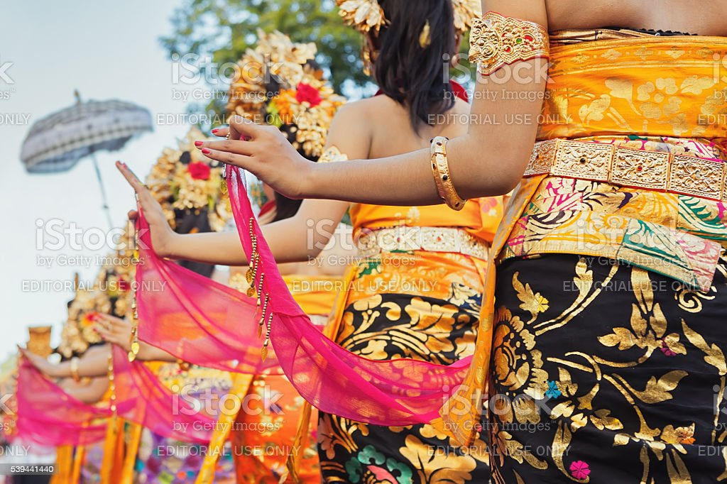 Balinese women in bright costumes with traditional decorations stock photo