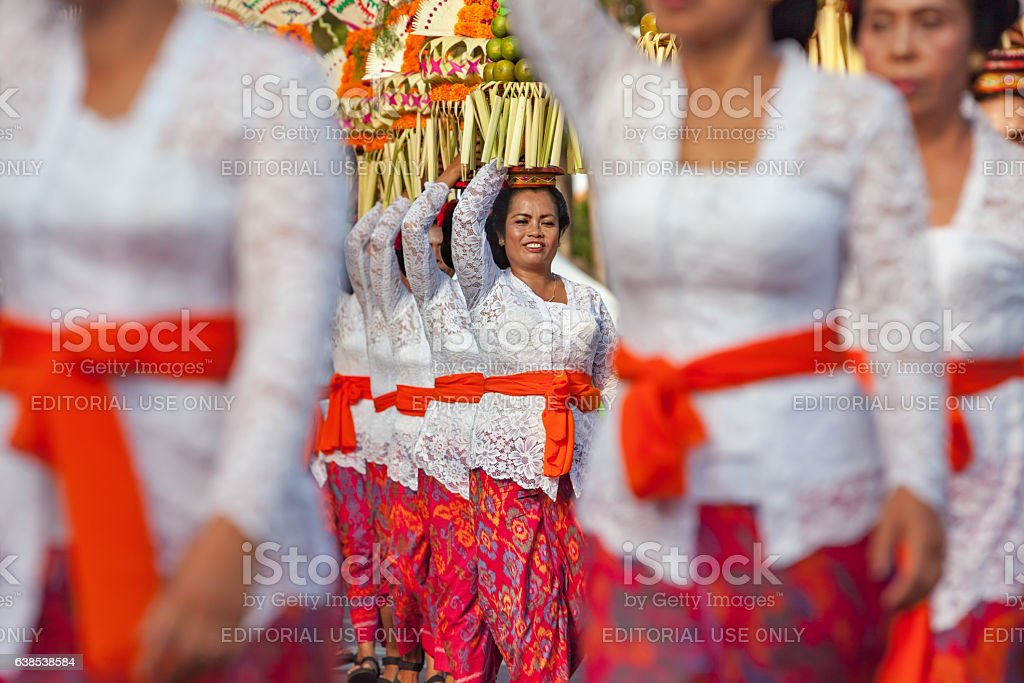 Balinese women with religious offering stock photo