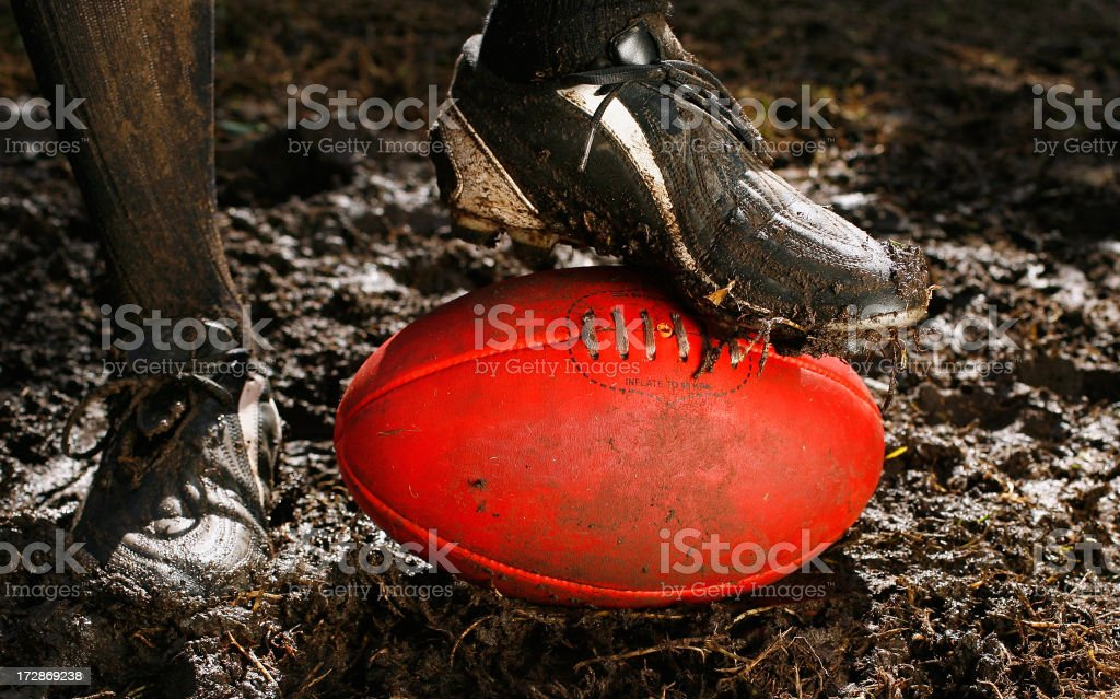 AFL Ball and Boot in Mud royalty-free stock photo