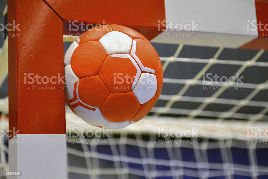 A ball hitting the inside post of a goal net stock photo