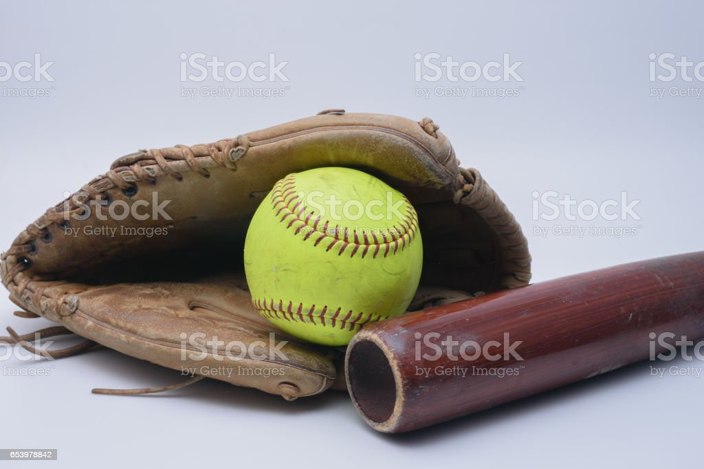 Ball in glove with wood bat stock photo