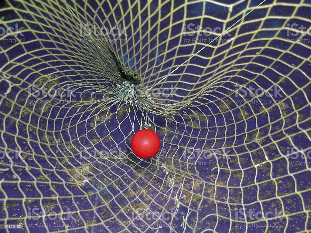 Ball in miniature golf net stock photo