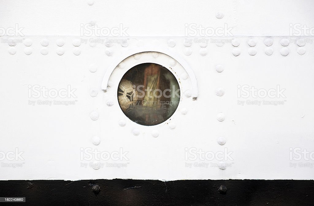 Ball in ship's porthole royalty-free stock photo