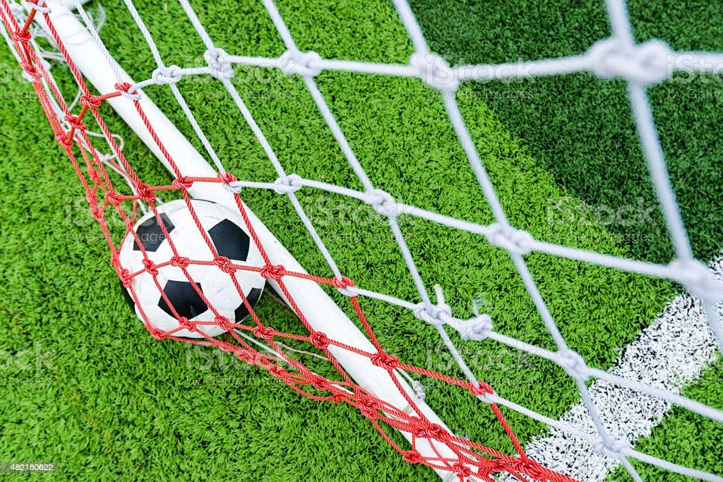 Ball in soccer goal net stock photo