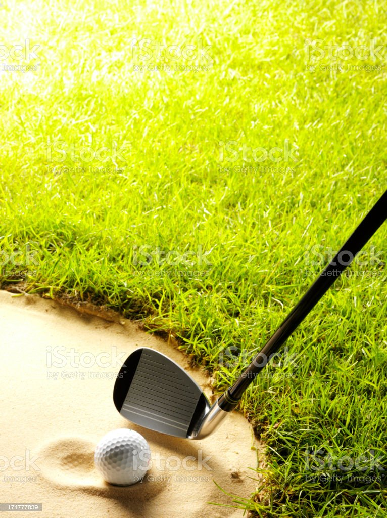 Ball in the Bunker on a Golf Course royalty-free stock photo