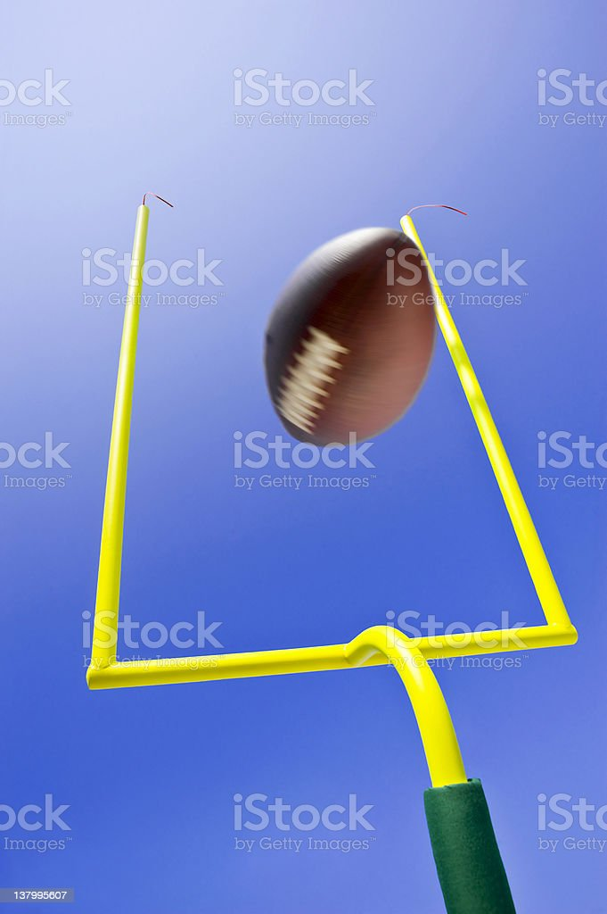 Ball kicked during field goal in game of American football stock photo