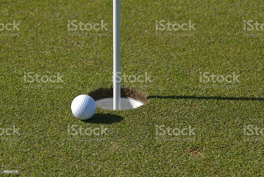 ball next to hole stock photo