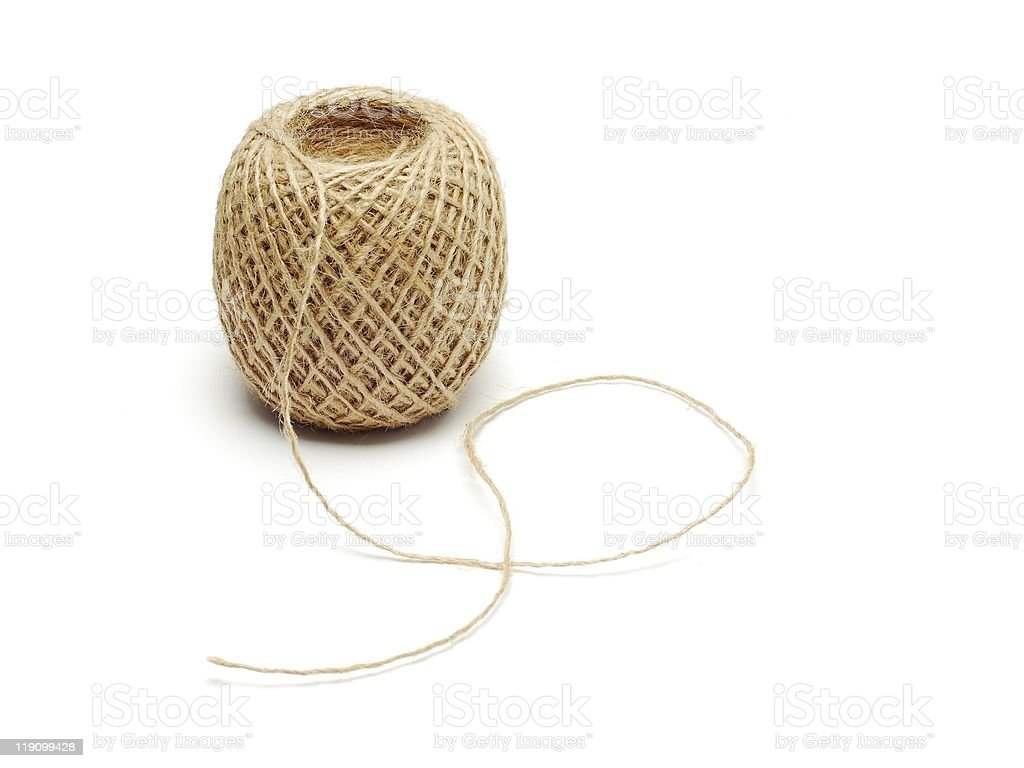 A ball of hemp string on a white background royalty-free stock photo