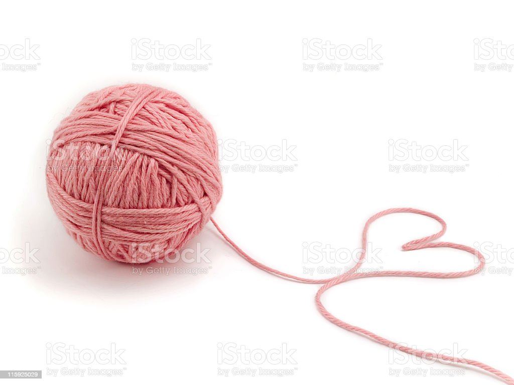 Ball of knitting yarn forming a heart royalty-free stock photo