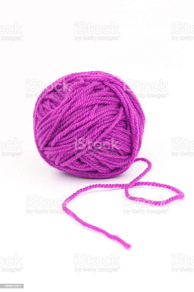 Ball of purple wool on a white background stock photo