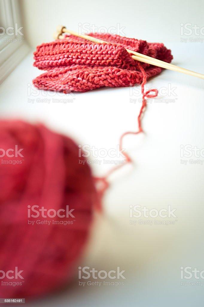 Ball of yarn and knitting needles stock photo
