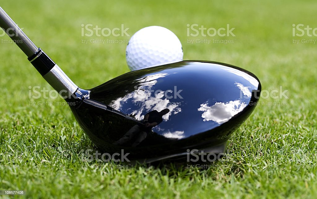 Ball on Tee with Reflection of Golfer in Golf Club royalty-free stock photo