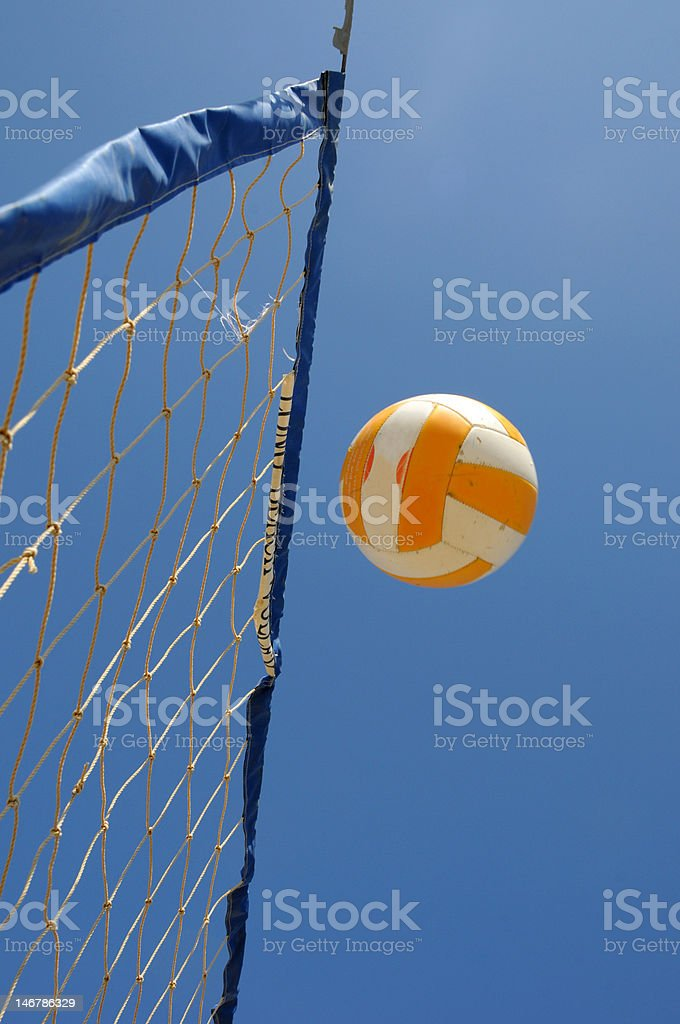 Ball over the a beach volleyball net royalty-free stock photo