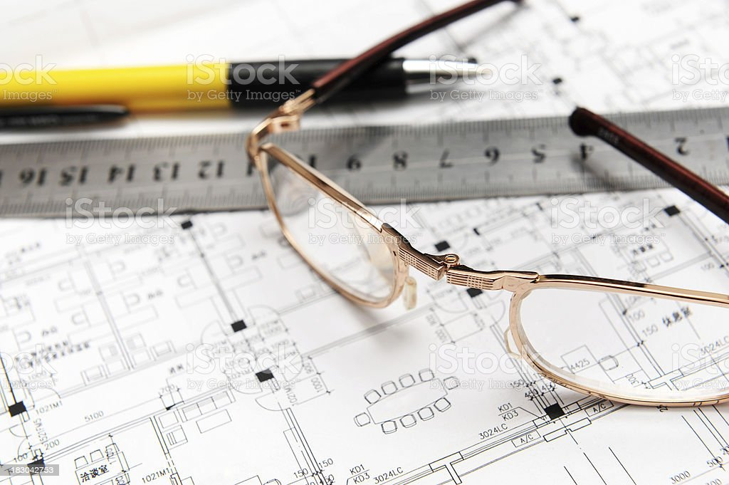 Ball point pen and Steel Ruler on Blueprint royalty-free stock photo