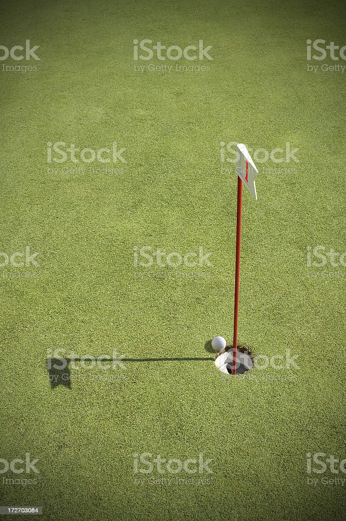 Ball putted into the hole royalty-free stock photo