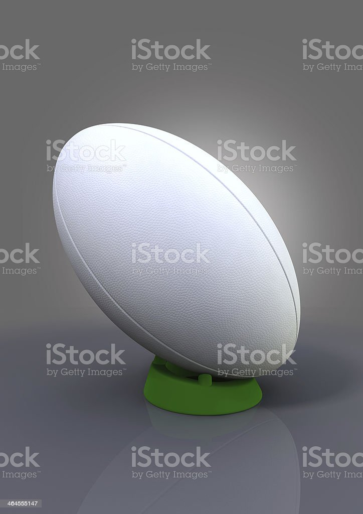 A ball that's used for playing Rugby on it's kicking tee  stock photo