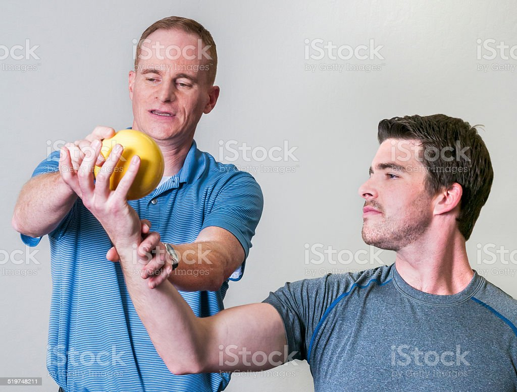 Ball Toss for Eccentric Rotator Cuff Strengthening stock photo