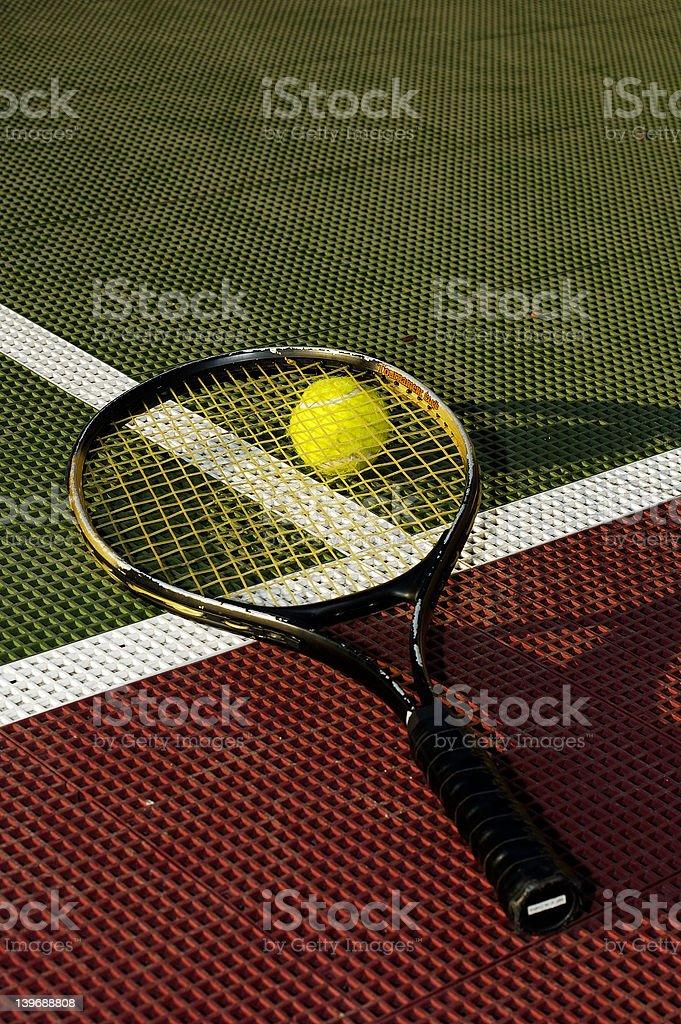 Ball Underneath Racquet royalty-free stock photo