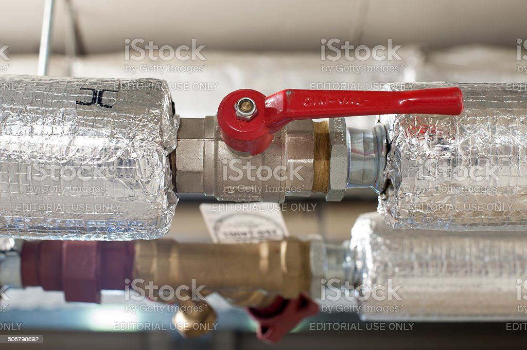 Ball valve in an pipe of a central heating system stock photo