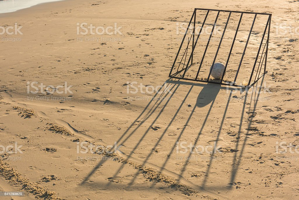 Ball with beach soccer goal. stock photo