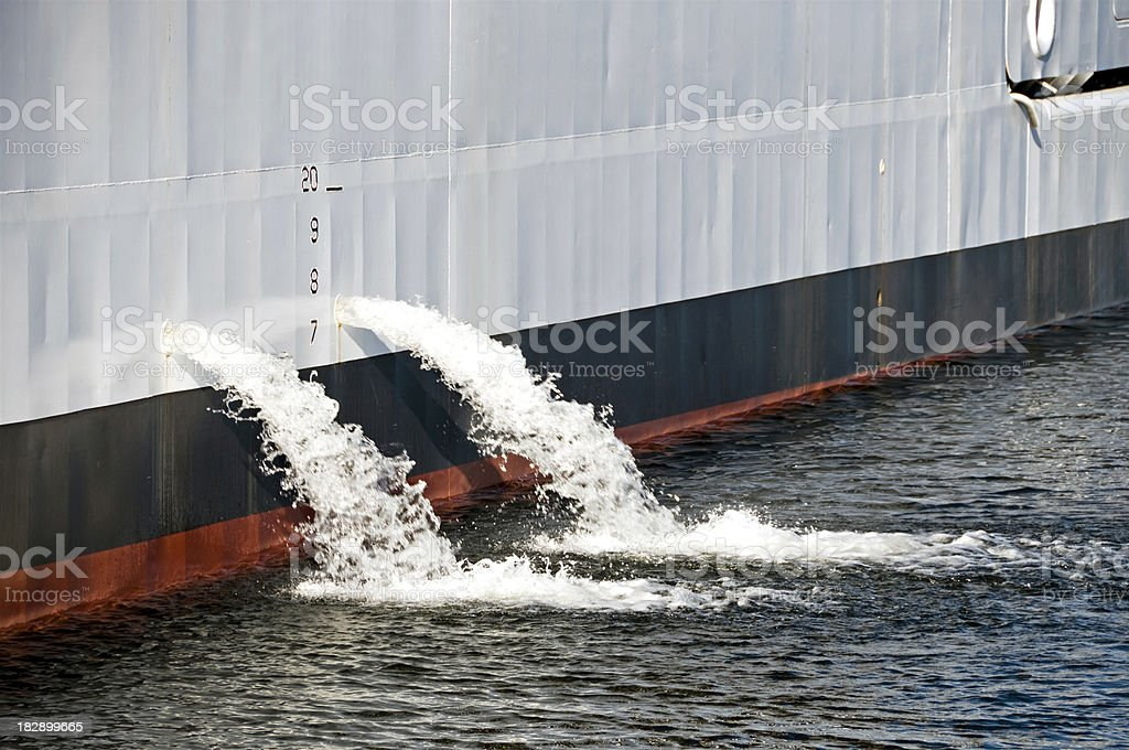 Ballast water pouring from ship stock photo