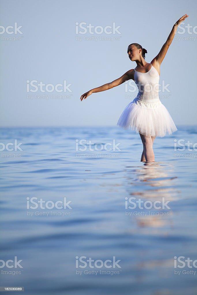 Ballerina dancing in the sea stock photo