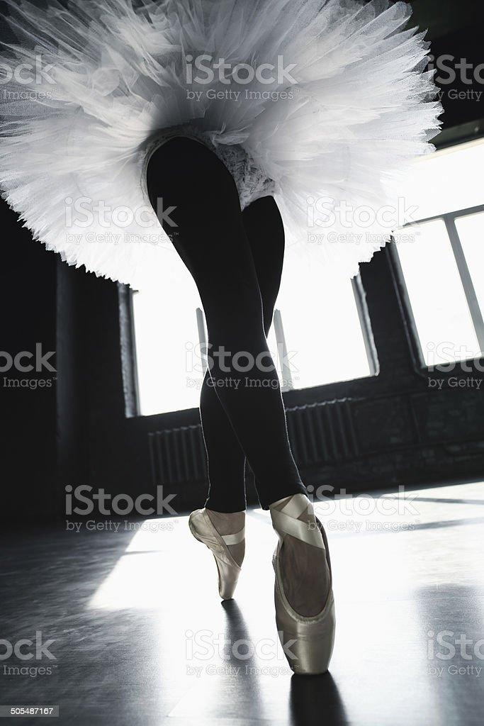 Ballerina dancing indoors stock photo