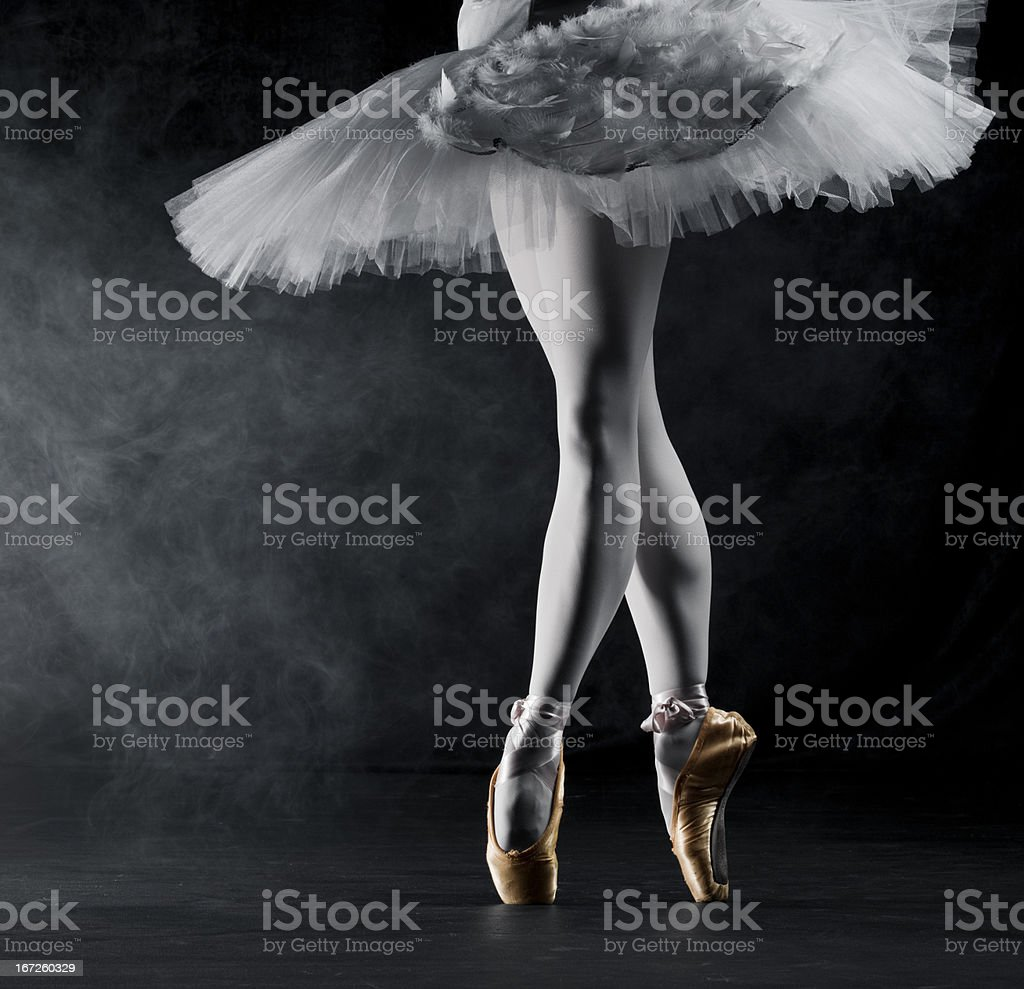 Ballerina en pointe on stage royalty-free stock photo