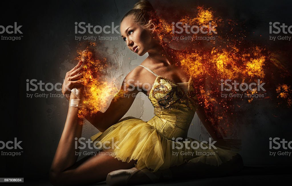 Ballerina in a fire stock photo