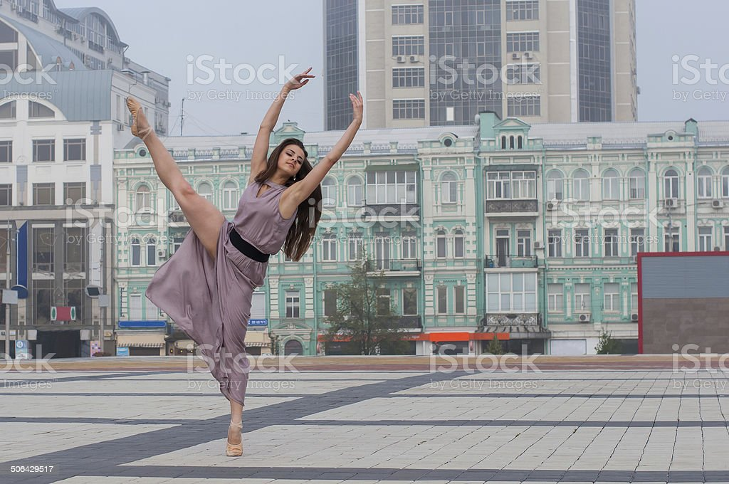 ballerina in casual clothes dancing in the street stock photo