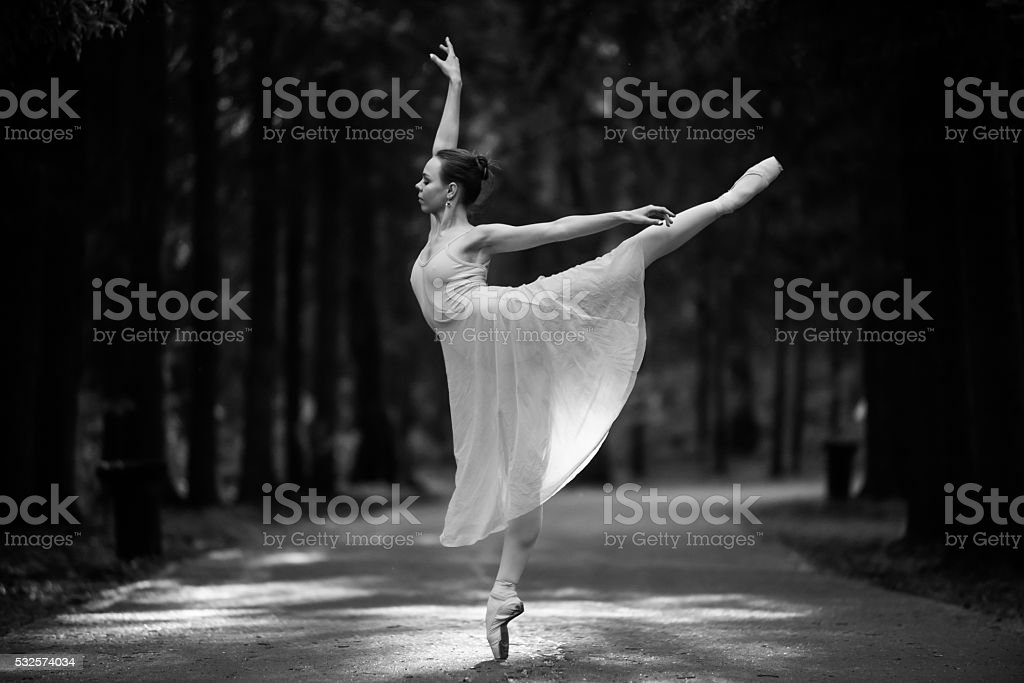 Ballerina in the park stock photo