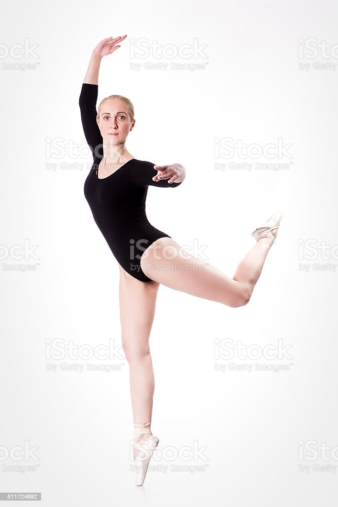 ballerina in training makes  jump in pointe stock photo