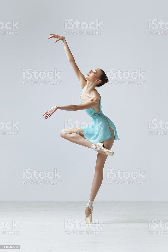 Ballerina in turquoise costume doing a ballet move stock photo