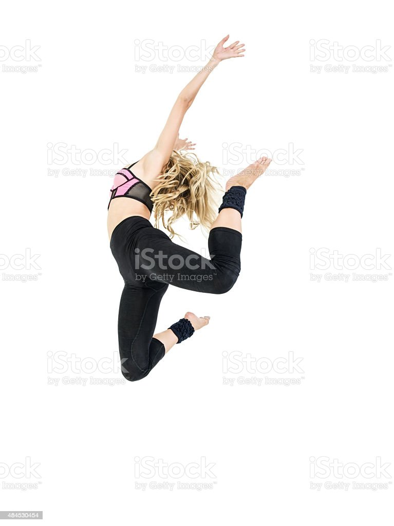Ballerina leaping in mid-air on white background stock photo