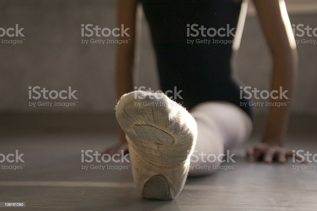 Ballerina Pointing Toe During Stretch royalty-free stock photo