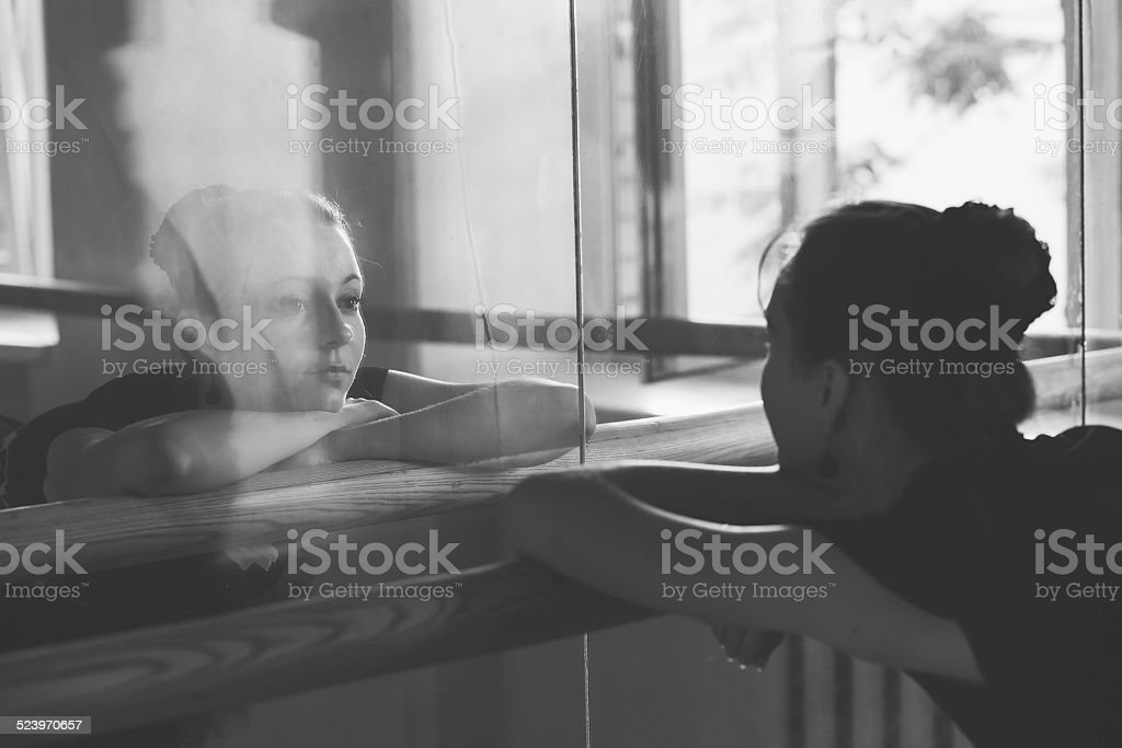 Ballerina  posing in front of the mirror stock photo