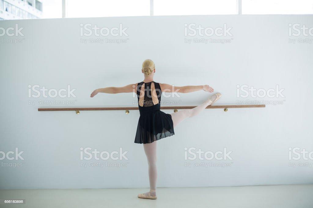 Rear view of ballerina practicing ballet dance in the studio