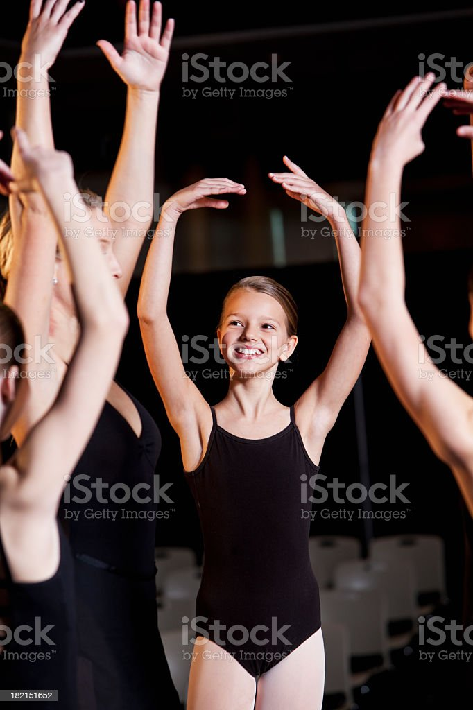Ballerina rehearsing with group of dancers royalty-free stock photo