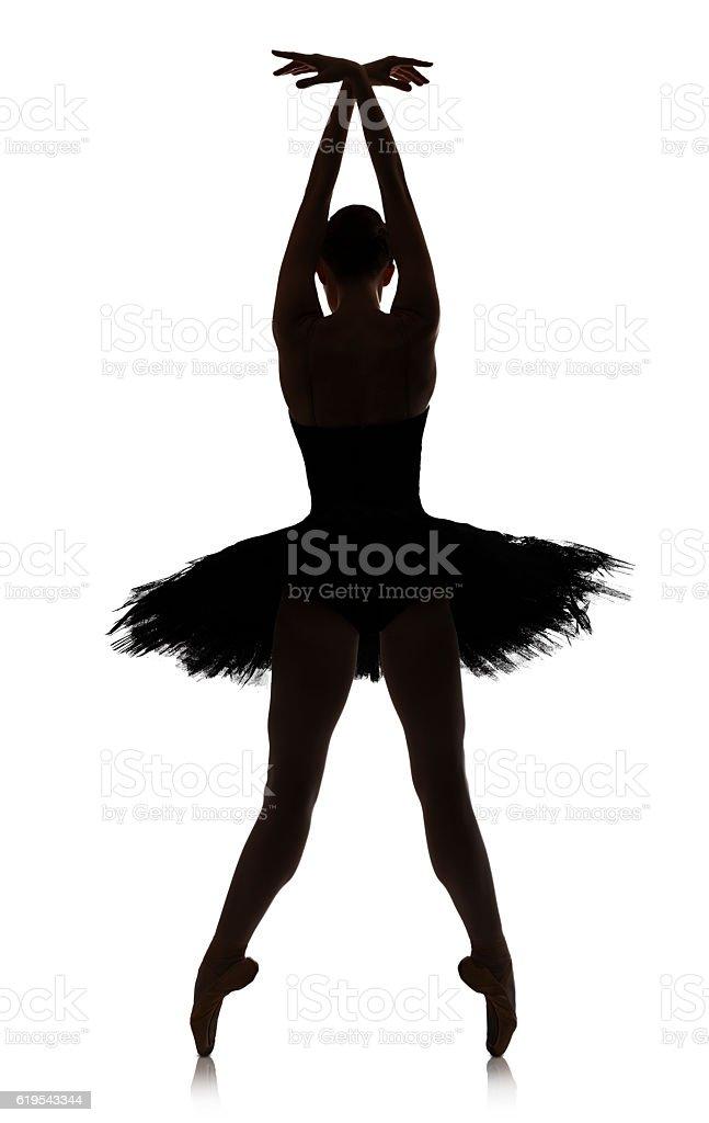 Ballerina silhouette making ballet position against white background, isolated stock photo