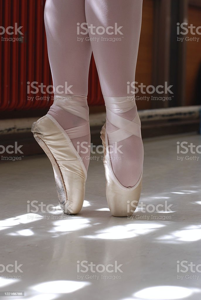 Ballerina standing on pointe shoes royalty-free stock photo