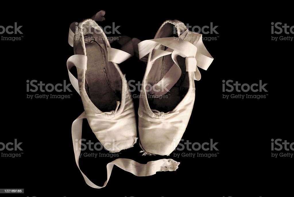 Ballerina: Worn Out Ballet Pointe Shoes Black Background stock photo
