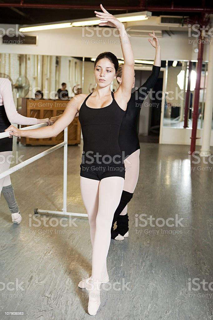 Ballerinas exercising at bar royalty-free stock photo