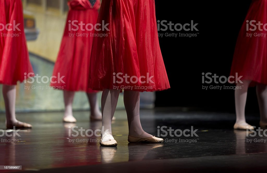 Ballerinas in red on stage stock photo