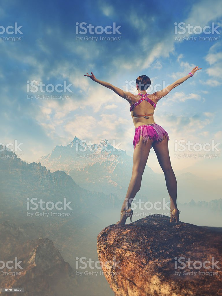 Ballet dancer celebrating beautiful sunset in the mountains royalty-free stock photo