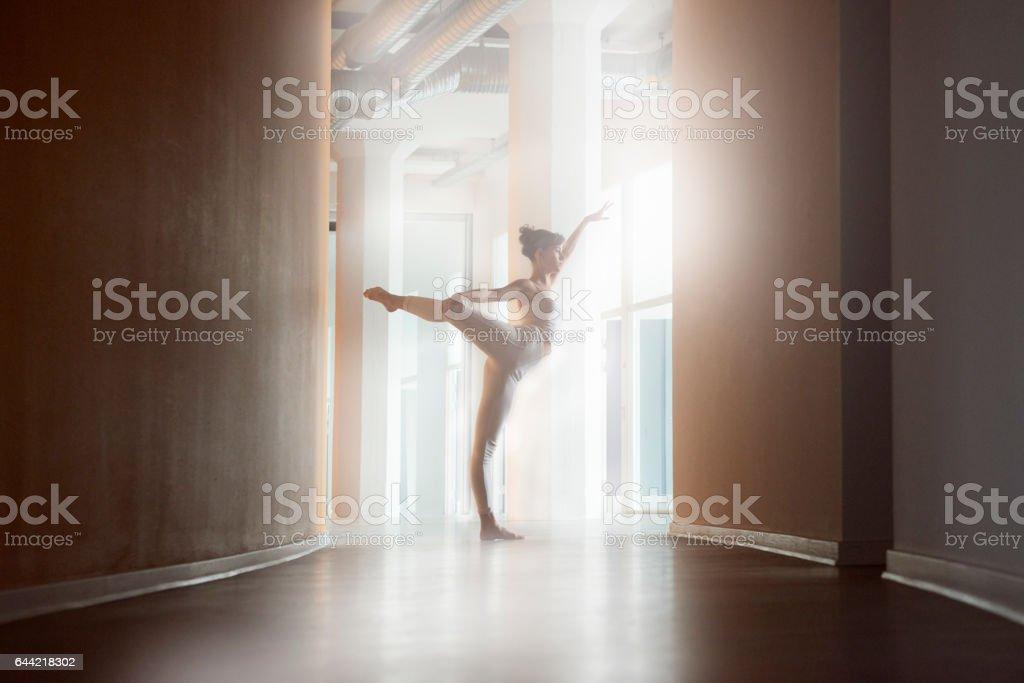 Ballet dancer doing her exercises stock photo